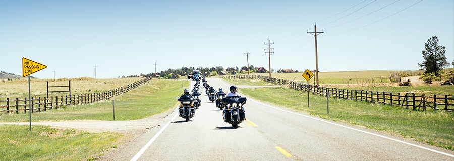 Motorcycle tour group riding through Utah on an EagleRider guided tour